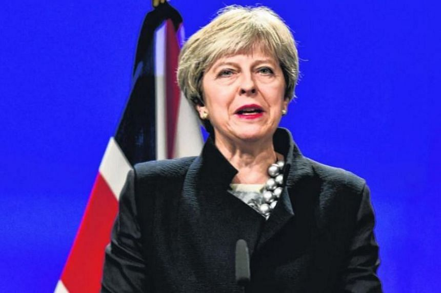 British Prime Minister Theresa May gives a speech as she attends a Brexit negotiations meeting on Dec 4, 2017, at the European Commission in Brussels.