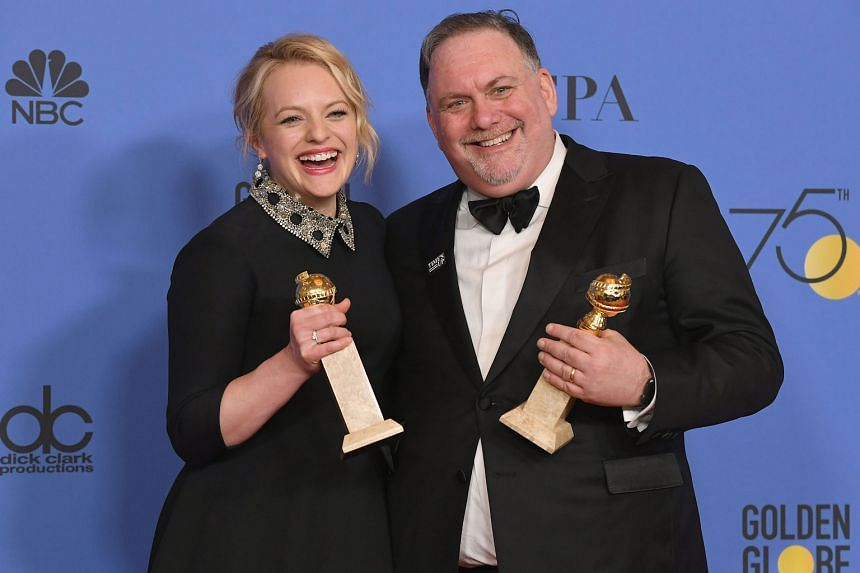 (From far left) Producers Elisabeth Moss and Bruce Miller of The Handmaid's Tale with their awards for Best Television Series Drama; This Is Us' Sterling K. Brown with his best actor prize; and Oprah Winfrey with the Cecil B. DeMille Award.