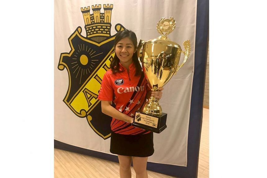 Singapore bowler Bernice Lim with the AIK International trophy. She beat top seed Jesper Svensson 240-233 with an eight-pin women's handicap in the step-ladder finals on Sunday.
