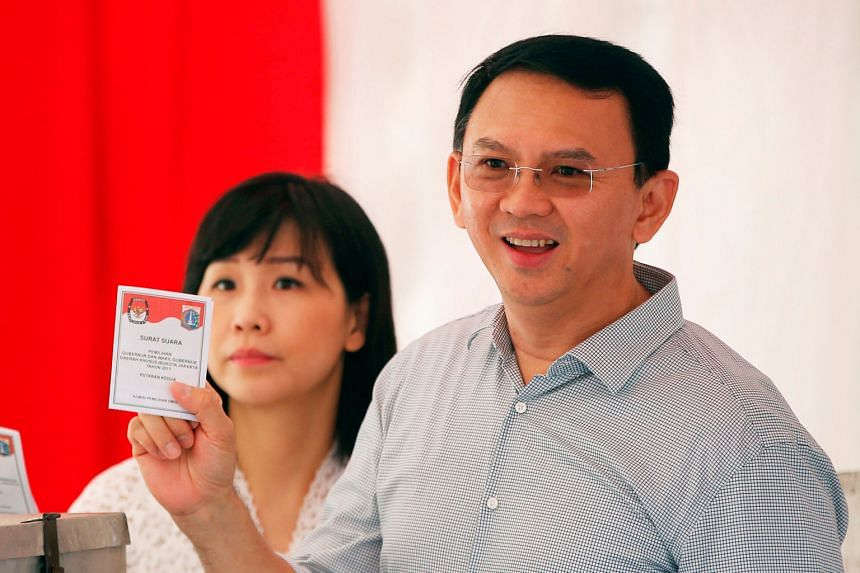 Basuki Tjahaja Purnama and his wife Veronica Tan voting during the Jakarta governor election last year. He filed for divorce last Friday.