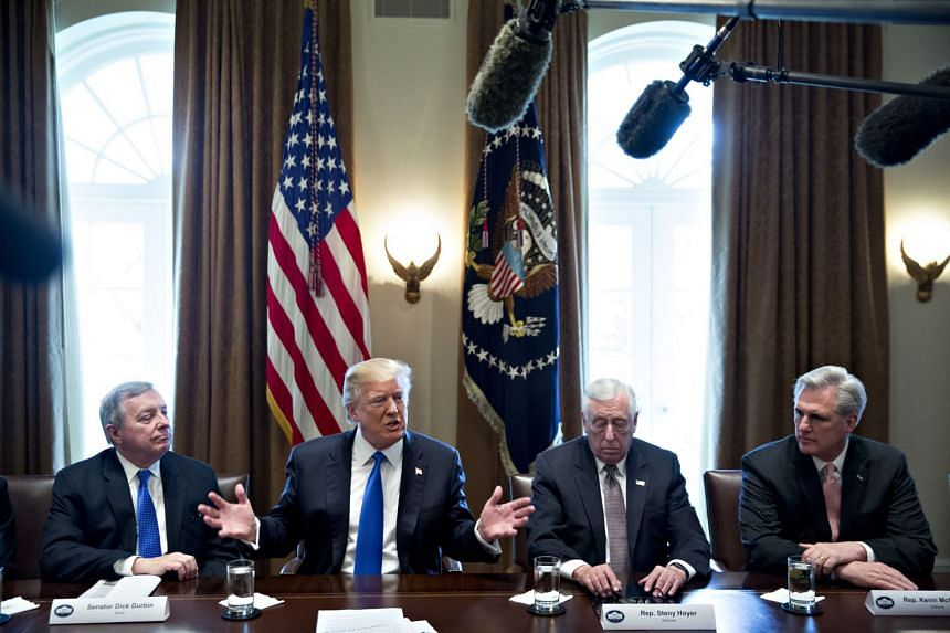 Trump hosts a meeting of bipartisan members of Congress on immigration in the Cabinet Room of the White House.