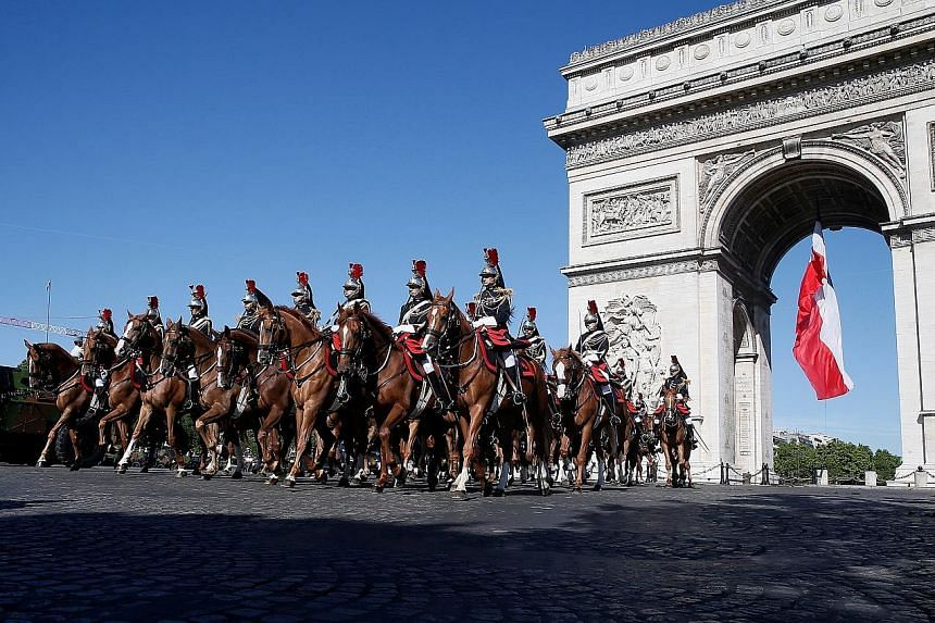 French Republican Guards on horseback during the Bastille Day military parade on the Champs-Elysees in Paris last year.