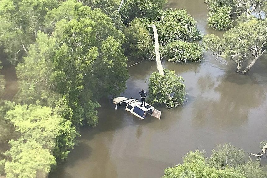 Most police officers are used to dealing with dangerous situations on the job, but one from Australia found himself needing to be rescued when he became stranded in crocodile-infested floodwaters in the Northern Territory yesterday. According to a Fa