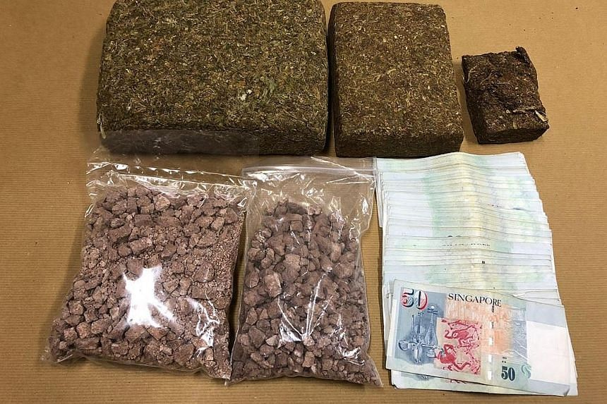 The cannabis, heroin and cash that were seized in the Central Narcotics Bureau operation on Monday.
