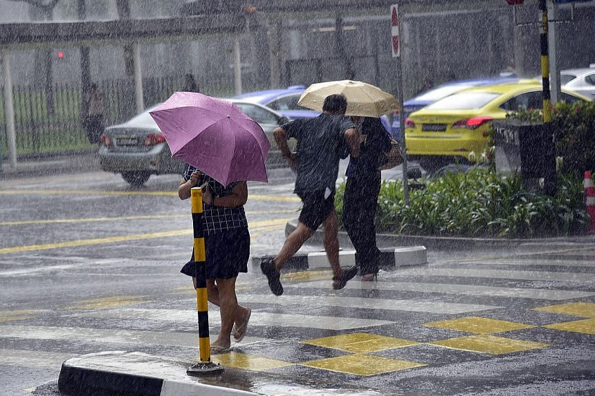 Heavy rain in North Bridge Road, near Peninsula Plaza, yesterday afternoon. There were thundery showers in areas like Bukit Merah, Clementi and Queenstown, and in the city.