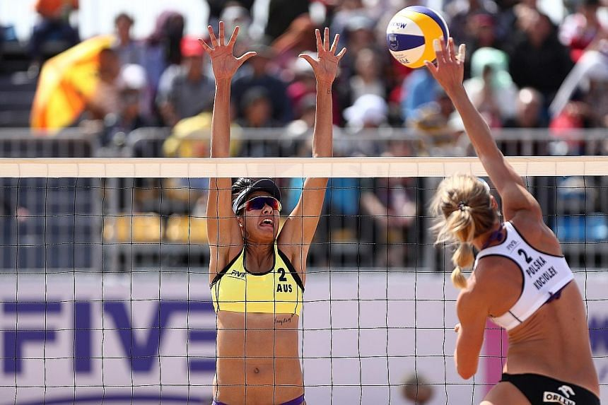 Taliqua Clancy of Australia attempting to block a spike from Poland's Katarzyna Kociolek during the final of the FIVB Beach Volleyball World Tour Qinzhou Open last October. Singapore is set to play host to some of the world's top beach volleyball pla
