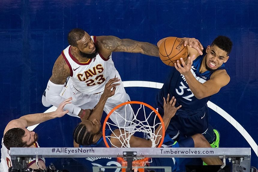 Minnesota centre Karl-Anthony Towns shooting as Cleveland forward LeBron James attempts to block him. The Cavs lost for the second time in third games on their road trip.