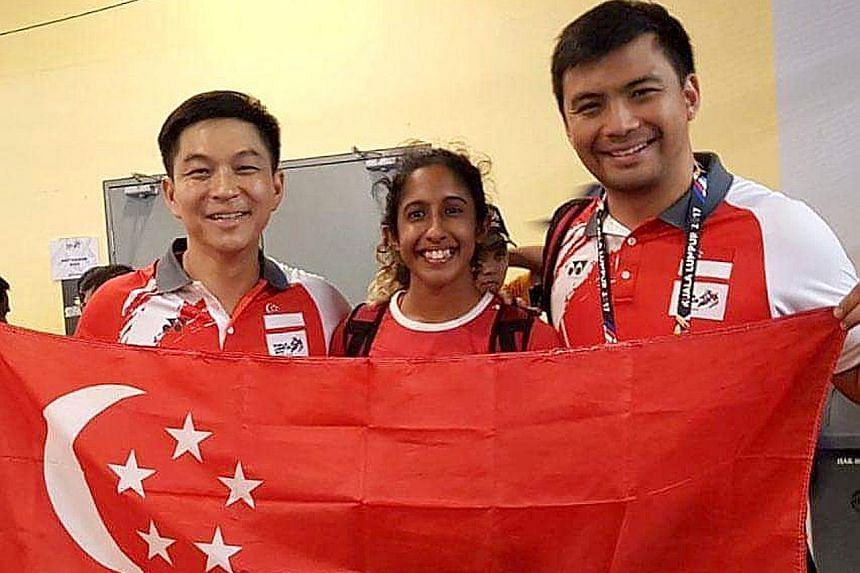 "Former national water polo vice-captain Yip Renkai (right) with SNOC president Tan Chuan-Jin and national sprinter Shanti Pereira at the Kuala Lumpur SEA Games in August. Yip says ""the call to connect and help local sports"" was a key reason he accept"