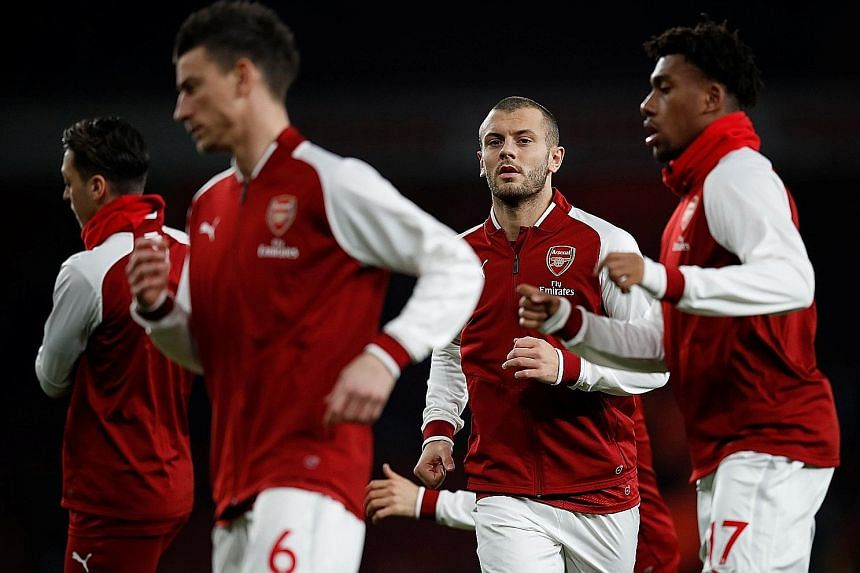 From left: Arsenal's Laurent Koscielny, Jack Wilshere and Alex Iwobi in training. Wilshere along with Mesut Ozil and Alexis Sanchez are all out of contract in the summer, with the club no closer to extending their deals.