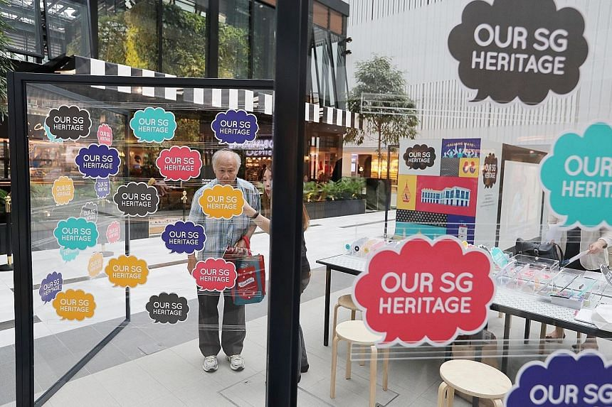 At the travelling roadshow at Raffles City Shopping Centre, visitors can learn about Singapore's first national heritage plan and give feedback.