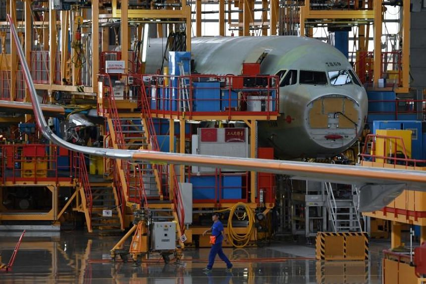 A worker walks past planes under construction at the Airbus A320 Family Final Assembly Line. The potential A320 order, which had not been previously announced, would be worth more than US$18 billion (S$24 billion) at list prices.