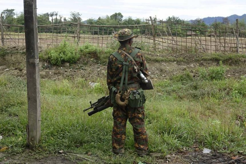 An armed soldier stands guard in Maungdaw township, Rakhine State, western Myanmar, on Jan 2, 2018.