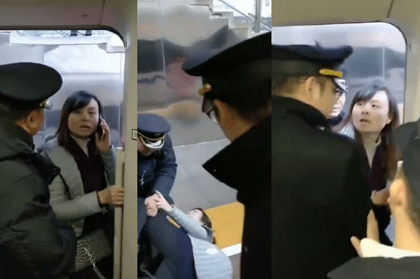 In the video, Ms Luo Haili was seen blocking the train's doors with her body to stop it from closing. At one point, station staff pulled her to the ground, but she struggled back to her feet and got to the door again before it closed.