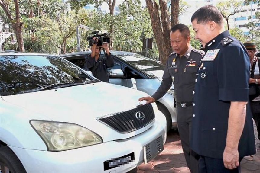 Malaysian police Criminal Investigation Department director Wan Ahmad Najmuddin Mohd (right) and Royal Thai Police adviser General Witaya Prayongpan looking at the vehicles which were handed over to the Malaysian police.