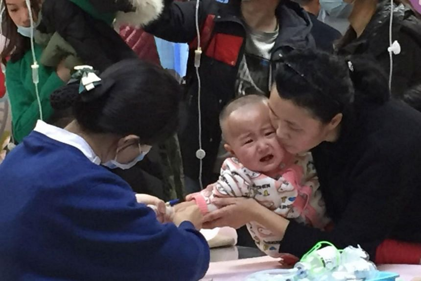A child with the flu is given an intravenous drip at Beijing Children's Hospital, on Jan 10, 2018.
