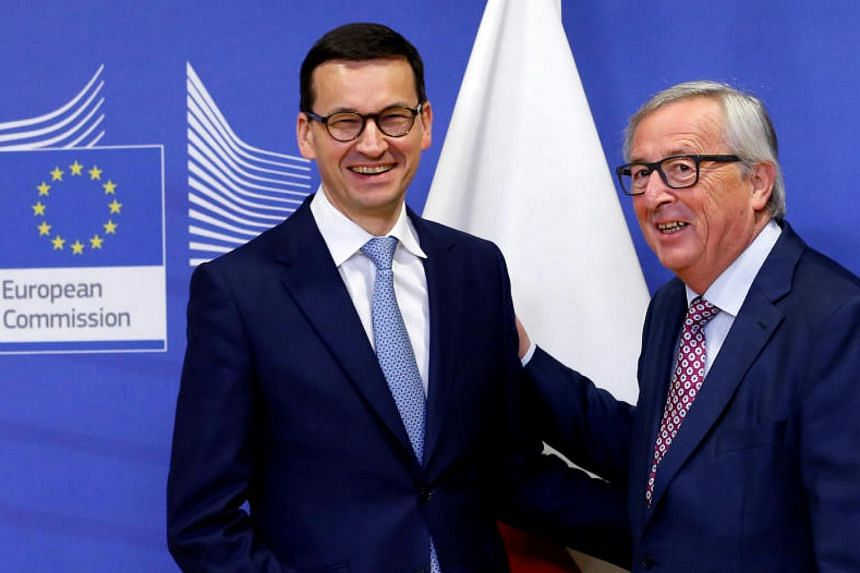Poland's new right-wing Prime Minister Mateusz Morawiecki (left) and European Commission President Jean-Claude Juncker at the EU Commission headquarters in Brussels, Belgium, on Jan 9, 2018.