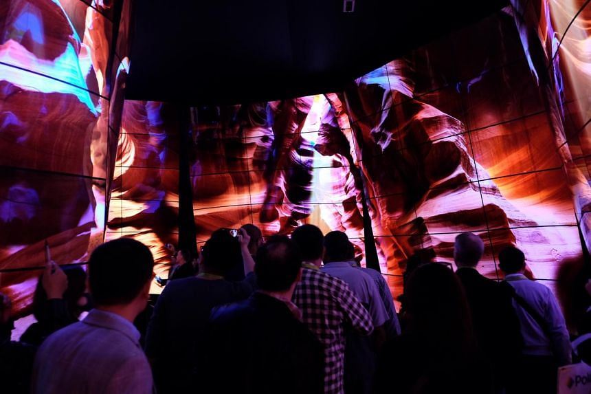 Visitors walking through LG's Oled Canyon are immersed in images that can make it seem like they are wondering through different environments.