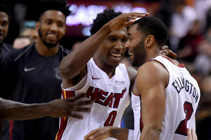 Miami Heat guard Wayne Ellington celebrates with guard Josh Richardson and teammates after scoring the winning basket against Toronto Raptors in the second half of the match at Air Canada Centre.