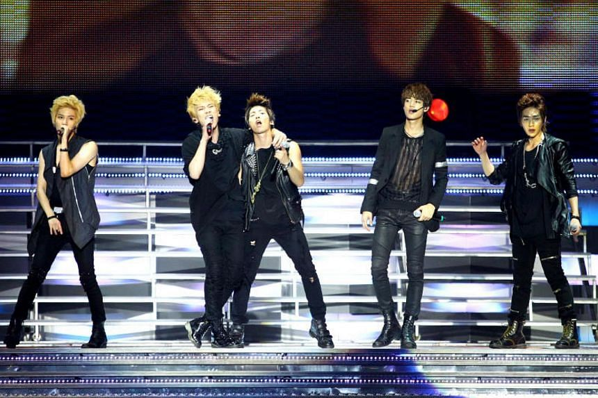 (From left) Members of K-pop boy band SHINee – Taemin, Key, Jonghyun, Minho and Onew performing at their SHINee World Concert at the Singapore Indoor Stadium on Sept 10, 2011.