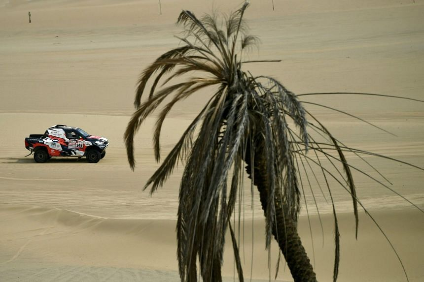 The Toyota Overdrive car driven by Andre Villas-Boas and co-driver Ruben Faria is seen racing during Stage 1 of the 2018 Dakar Rally between Lima and Pisco, Peru, on Jan 6, 2018.