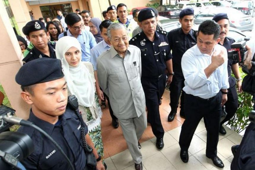 Dr Mahathir Mohamad (centre) and Ms Nurul Izzah Anwar at the Cheras Rehabilitation Hospital on Jan 10. They tried, but failed to obtain permission to visit Anwar Ibrahim.