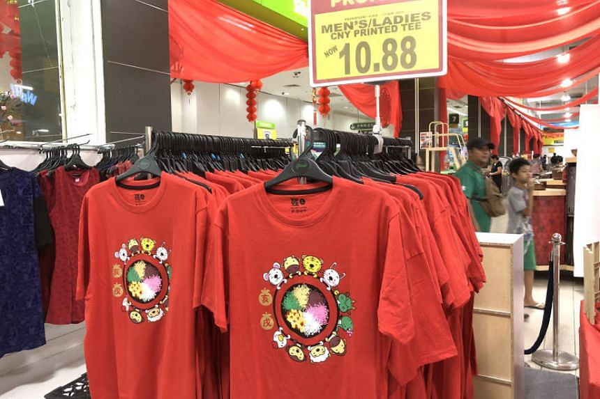 Chinese across the world will usher in the Year of the Dog next month, but Malaysian Chinese are seeing red over zodiac animals missing from a festive T-shirt.