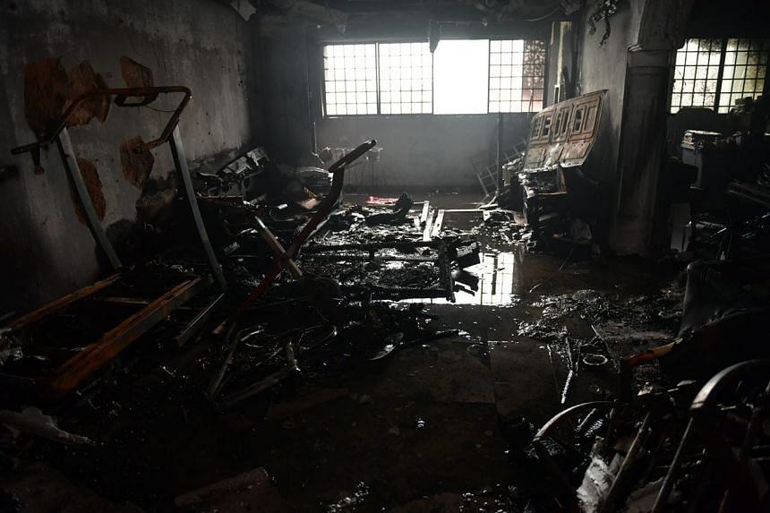 The fire, which burnt the flat's living room, was put out using two water jets.