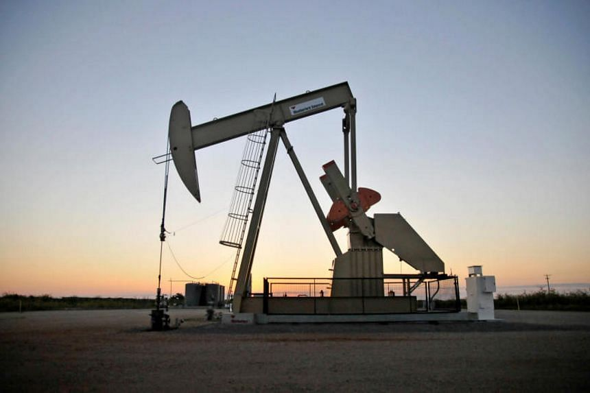A pump jack operates at a well site leased by Devon Energy Production Company near Guthrie, Oklahoma.