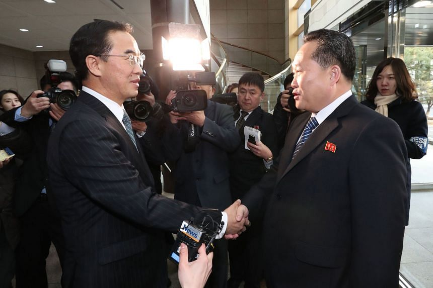 South Korean Unification Minister Cho Myoung Gyon (left) greeting North Korean chief delegate Ri Son Gwon before their meeting at the border truce village of Panmunjom in the Demilitarised Zone dividing the two Koreas yesterday.