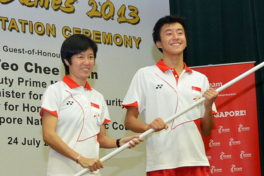 """Tan Paey Fern (left) and swimmer Quah Zheng Wen in 2013, during the flag presentation ceremony for the Nanyang Asian Youth Games. Tan said it is a """"privilege"""" to be a part of Team Singapore's first Winter Olympics outing."""