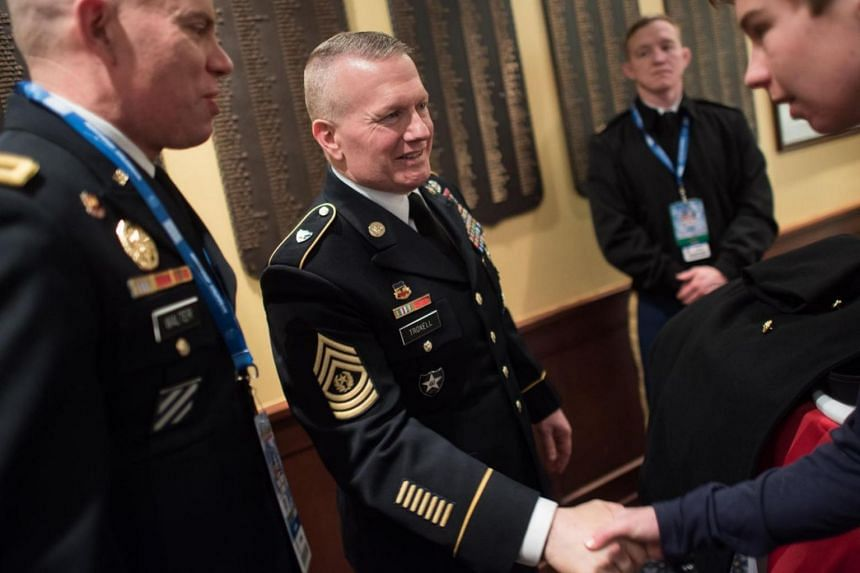 """Command Sergeant Major John Troxell (centre) warned that ISIS members who refuse to quit will be dispatched with """"extreme prejudice,"""" including via a small shovel known as an entrenching tool."""