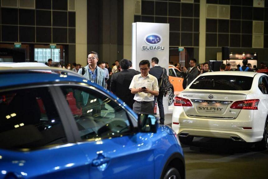 Visitors looking at vehicles on display at the Singapore Motorshow.