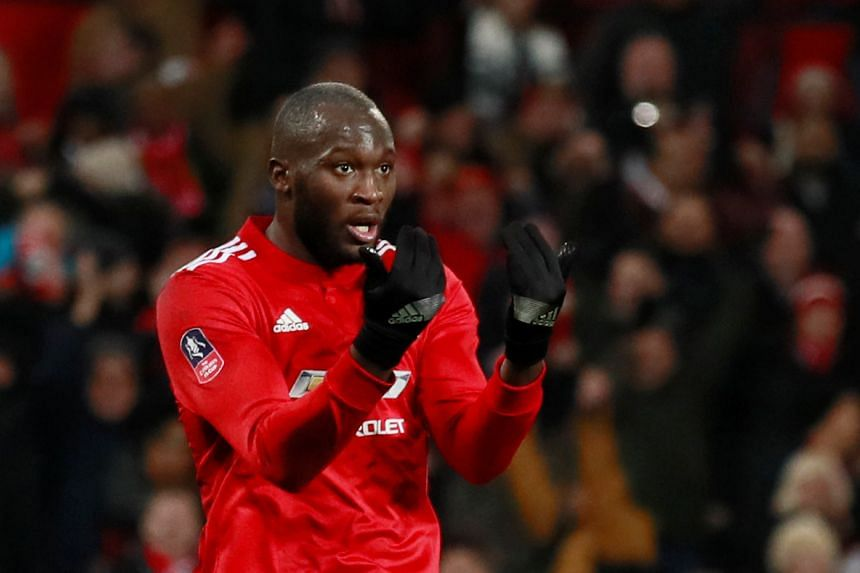 Lukaku celebrates an FA Cup goal for United against Derby County.