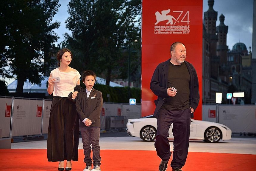 Chinese artist Ai Weiwei arriving with his wife Lu Qing and son at the premiere of his movie Human Flow presented in competition at the Venice Film Festival last year.