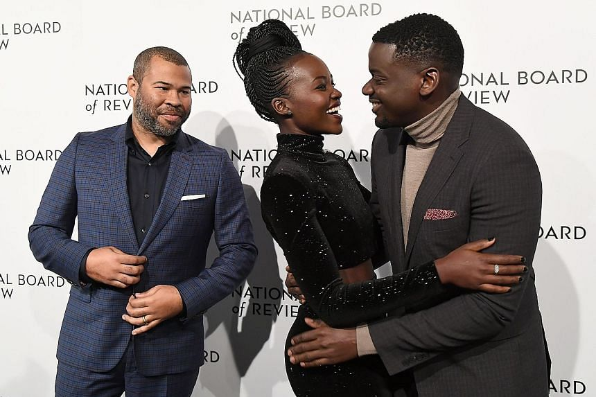 Colour returned at the National Board of Review Awards Gala in New York on Tuesday, two days after stars wore black to the Golden Globes in support of sexual harassment victims. Actress Gal Gadot (extreme left), in blue, picked up the Spotlight Award