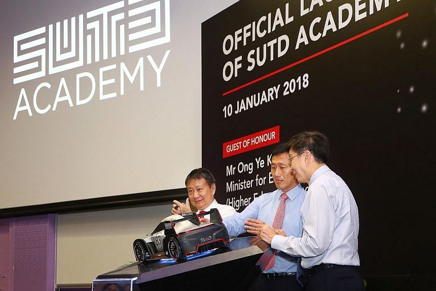 From far left: SUTD chairman Lee Tzu Yang, Education Minister (Higher Education and Skills) Ong Ye Kung and the university's acting president and provost Chong Tow Chong pressing a touchpad to officially launch SUTD Academy yesterday. The academy wil