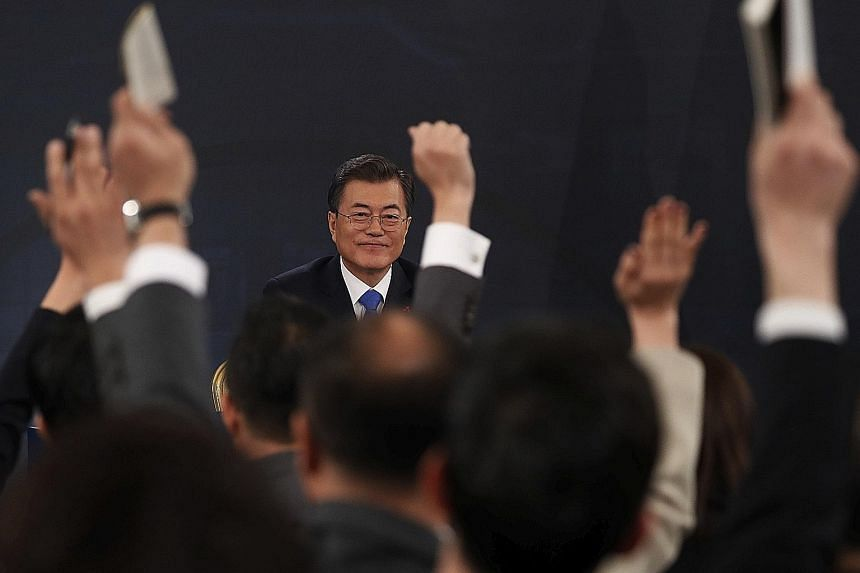 """South Korean President Moon Jae In during the New Year's press conference at the Presidential Blue House in Seoul yesterday. He pledged to remain committed to """"people-centred"""" economic growth."""