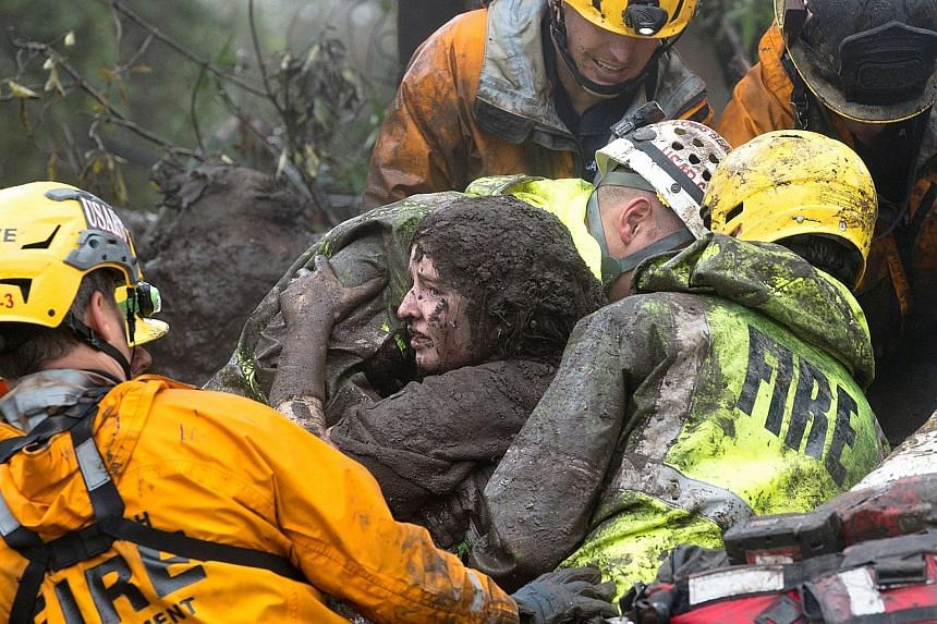 A woman being rescued from a collapsed house in Montecito on Tuesday.