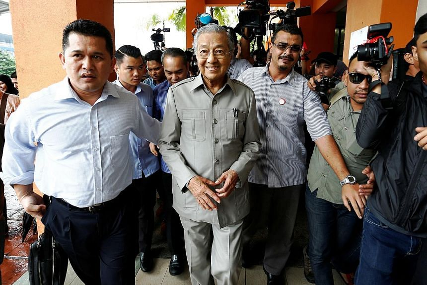 Dr Mahathir arriving yesterday afternoon at Cheras Rehabilitation Hospital in Kuala Lumpur, where Anwar is recuperating after surgery on his right shoulder in November. He wanted to thank Anwar for consenting to his nomination as prime minister desig