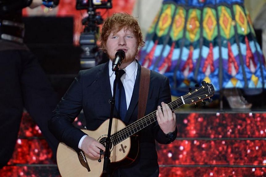 Singer-songwriter Ed Sheeran performs at the Miss France 2018 beauty pageant in Chateauroux, central France, on Dec 16, 2017.