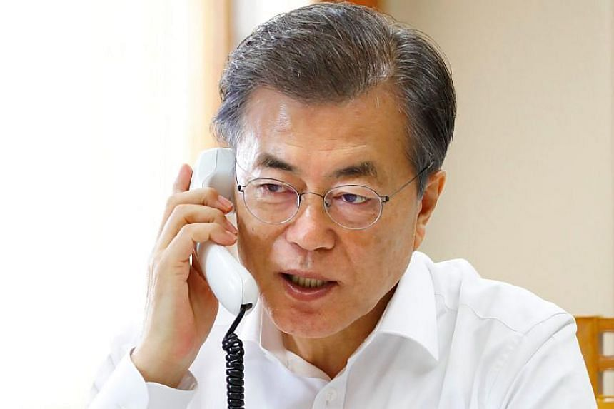 South Korean President Moon Jae In speaks over the telephone with US President Donald Trump at the presidential Blue House in Seoul on Nov 29, 2017.