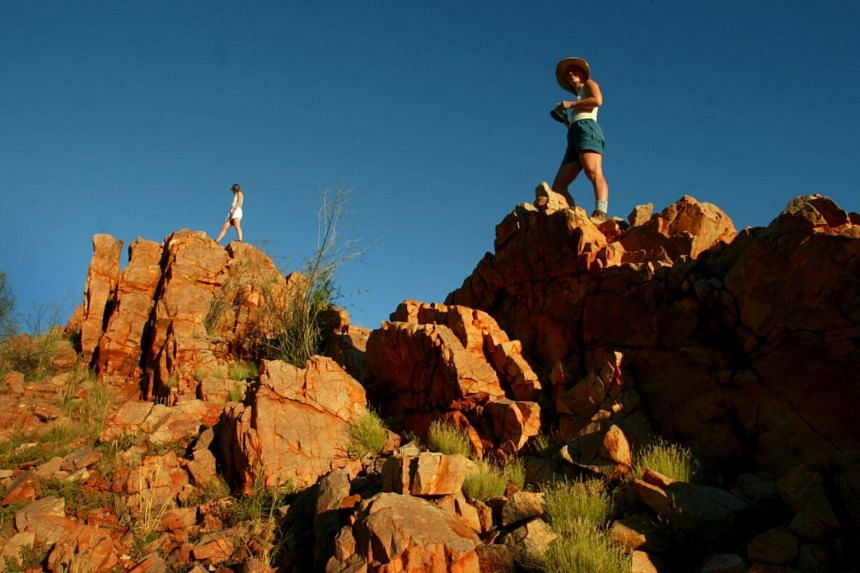 Two tourists walking along the Larapinta Trail in Australia's Northern Territory. A Californian man died after getting separated from his hiking partner along the trail, with rescuers finding his body on Jan 11, 2018.