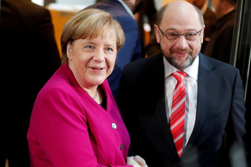 Acting German Chancellor Angela Merkel and Social Democratic Party leader Martin Schulz at the SPD headquarters in Berlin, on Jan 7, 2018.