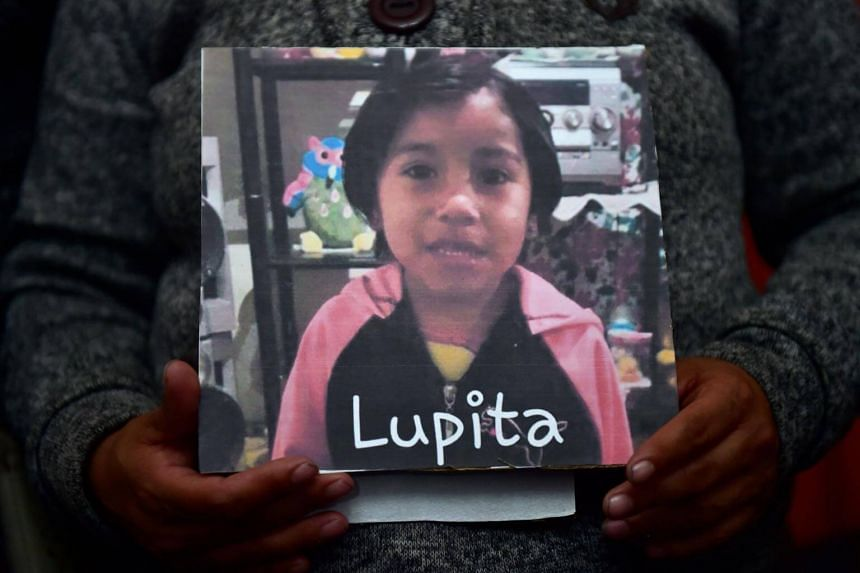 Luz Maria Medina holds a photo of her four-year-old niece Lupita, during a press conference in Mexico City, on Jan 10, 2018.