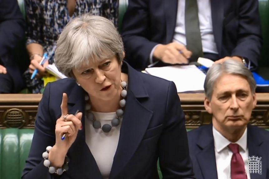 Britain's Prime Minister Theresa May at the weekly Prime Ministers Questions session in the House of Commons in central London on Jan 10, 2018.