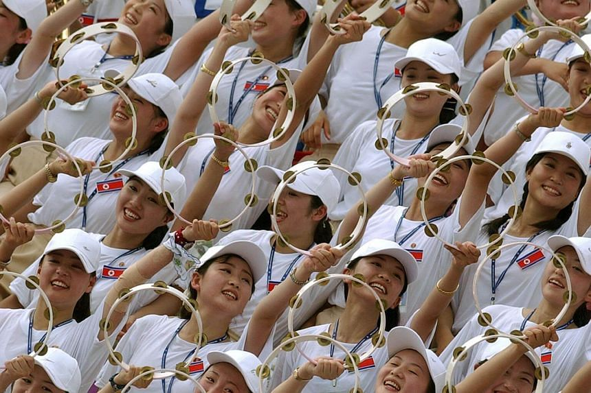 North Korean cheerleaders at a women's football match against Germany in Gimcheon Stadium on Aug 22, 2003.
