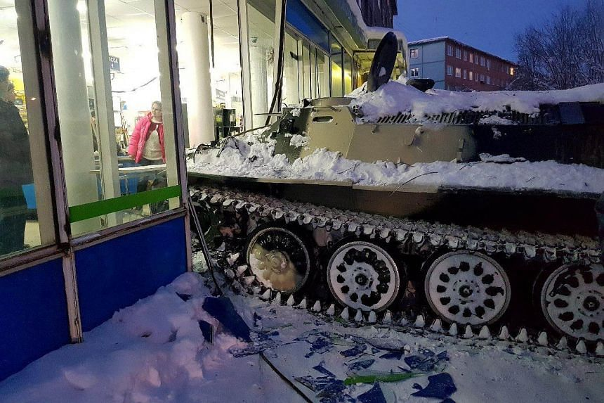 A man rammed an armoured personnel carrier into a shop window in the town of Apatity, Russia, on Jan 10, 2018.