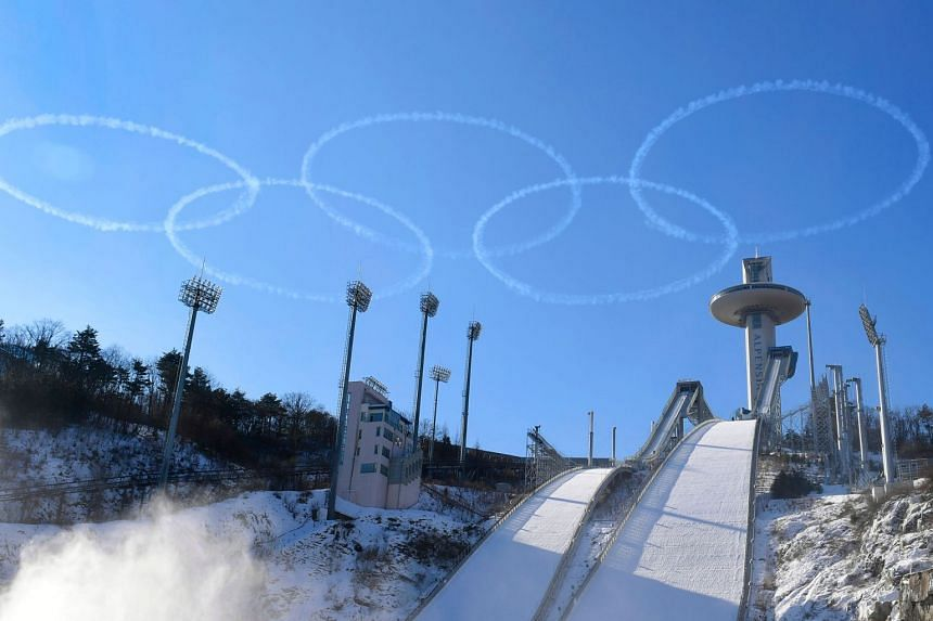 Members of the South Korea Air Force's Black Eagles aerobatics team form the Olympic rings in the sky over Pyeongchang, on Jan 10, 2018.