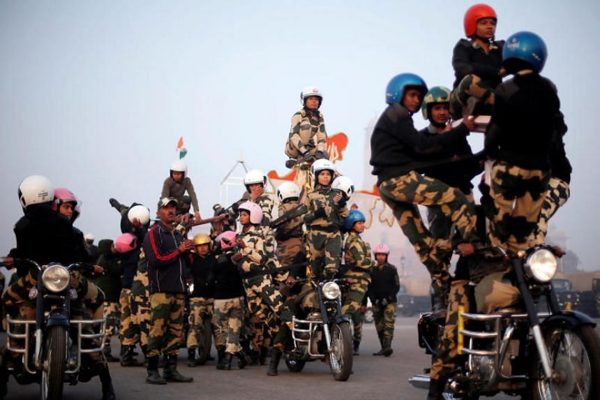"India's Border Security Force (BSF) ""Daredevils"" women motorcycle riders perform during a rehearsal for the Republic Day parade on a cold winter morning in New Delhi, India, on Jan 10, 2018."