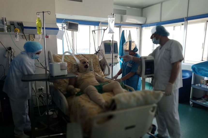 Ryad Khalaf Zibou receiving medical attention at a hospital in the northern Lebanese city of Tripoli.